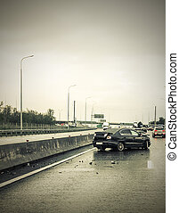 car accident on the rainy highway