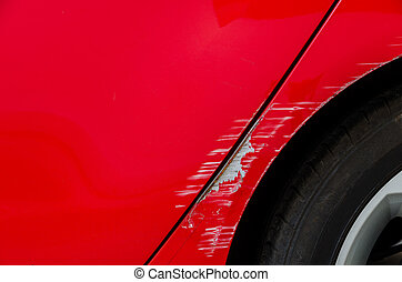 Car accident - Smashed body of red car