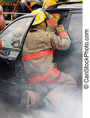 Car accident. - Fireman at the scene of a car accident.