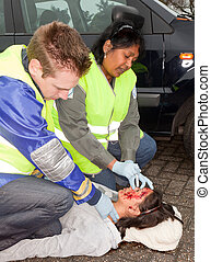Car accident victim - Paramedics checking a woman injured...