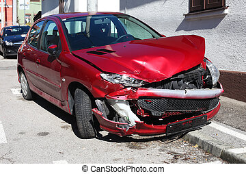 car accident - Wrecked red car on the street pavement