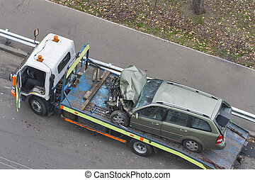 car after road accident shipped to tow truck
