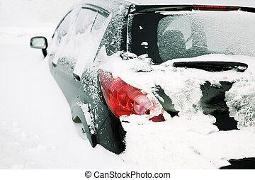 car after snowfall - winter urban concept (natural disaster...