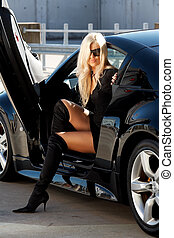 Car and babe - Glamorous blond babe in tuned supercar