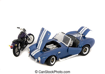 A toy car (AC Cobra) and a toy motorbike