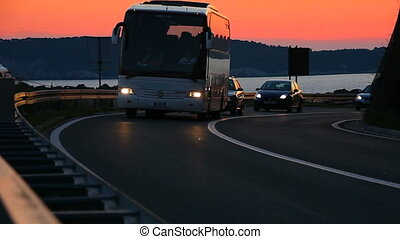 Car and buss drivin in sunset color