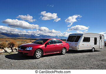 Car and Campervan - Car and campervan on a road in south...
