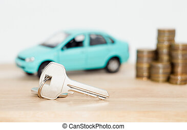 car and coins on a white background