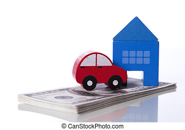 Car and House investment - red car and blue house over a lot...