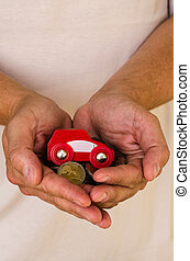 car and money in hands