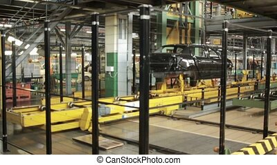 Car assembly at factory - New car putting on automatic...