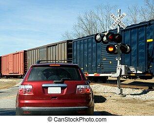 car at railroad crossing - car waiting for freight train at...