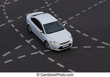 Car at the crossroads of multi-lane roads.
