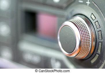 Car Audio - Tunning knob close up shot of modern car audio
