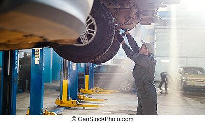 Car automobile service - mechanic checks the luxury SUV