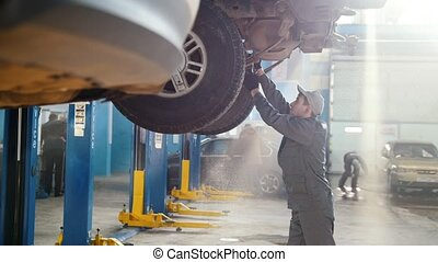 Car automobile service - mechanic checks the luxury SUV,...