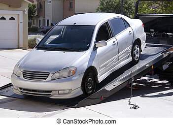 Car being towed away by a truck