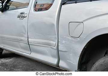 Car body side damage after an road traffic accident, close- up