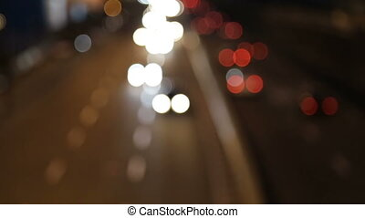 Car bokeh on the night freeway - Cars out of focus on the...