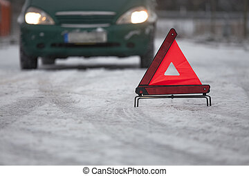 car breakdown with warning triangle
