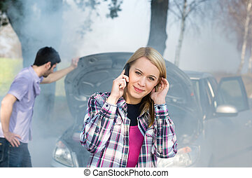 Car breakdown woman call for help road assistance smoking...