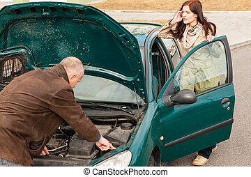 Car breakdown woman calling for road assistance