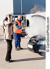 Car breakdown woman get help road-assistance man - Woman...