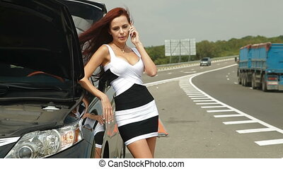 Car Breakdown - Woman having car troubles on the road,...
