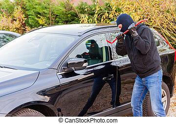 Car burglar in action - A burglar in action to rob something...