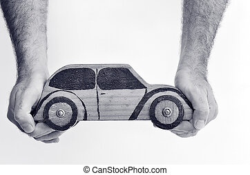 Car Business Concept - Hands and toy car isolated on white...