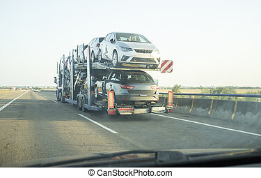 Car carrier trailer on divided highway road