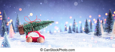 Car Carrying A Christmas Tree in The Snowy Forest At Night