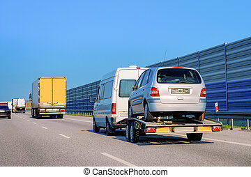 Car carrying trailer with new vehicles at road of Slovenia