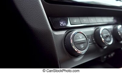 Setting car air conditioning system direction.