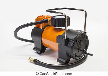 Car compressor on light background