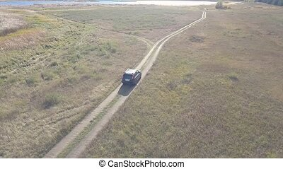 Car country aerial - Aerial view off-road car moving on...