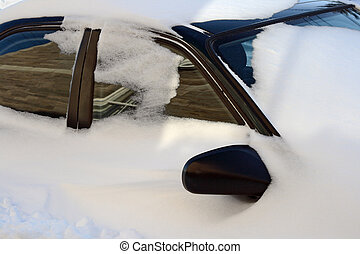 Car covered by snow