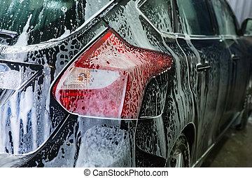 car covered with foam -  car covered with foam on car wash