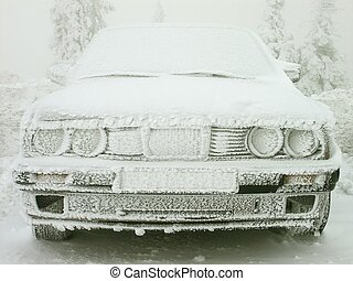 Car covered with frost - Frozen car standing on the top of...