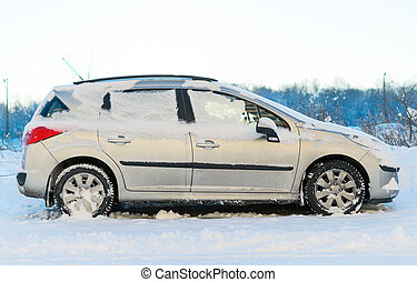 Car covered with snow in the winter.