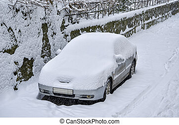 Car covered with snow on the street