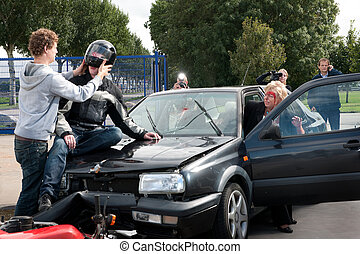 Car crash scene - Various things happening just after an...