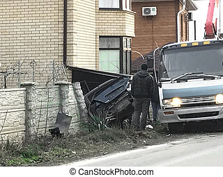 car crashed into a fence