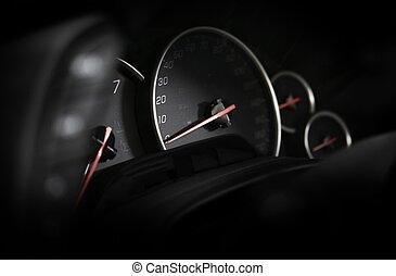 Car Dashboard - Vehicle Instruments. Speedometer in the Dark...