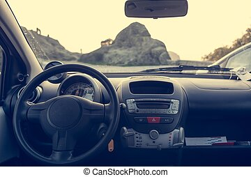Car dashboard with a mountain view