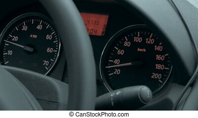 Car dashboard with low speed shown - Close-up shot of...