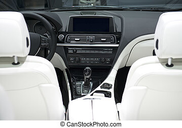 Car Dashboard With White Leather Seats