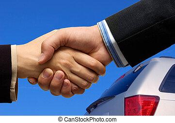 Car Deal - Asian woman and Caucasian man shaking hands