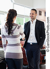 Car dealer shaking hand with a customer