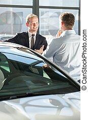 Car dealer showing auto